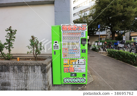 the  machines with ticket on a street 38695762