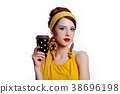 girl in 70s clothes style with coffee cup 38696198