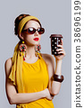 girl in 70s clothes style with coffee cup 38696199
