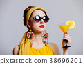 girl in 70s clothes style with tropical cocktail 38696201