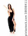 Young beautiful woman in a black dress with a 38698411