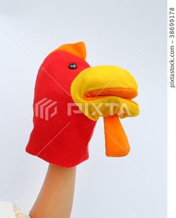 Hand wearing children puppets, Chicken head 38699178