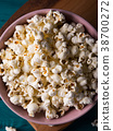 Popcorn in pink bowl on dark background 38700272