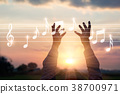Hands touching music notes on nature background 38700971