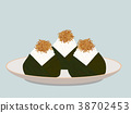 Onigiri topped with small fish fry on the plate. 38702453