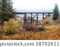 Wooden railroad bridge. 38702611