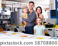 parents with kids in store 38708800