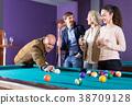 people having pool game 38709128