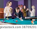 Ordinary people having pool game 38709201