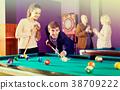 People playing billiard 38709222