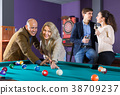 people having pool game 38709237