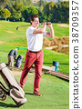 Male golf player made successful hit at golf course 38709357