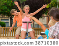 Children are teetering on the swing 38710380