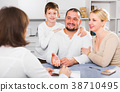 Happy family meeting financial adviser 38710495