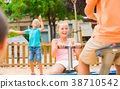 Children are teetering on the swing 38710542
