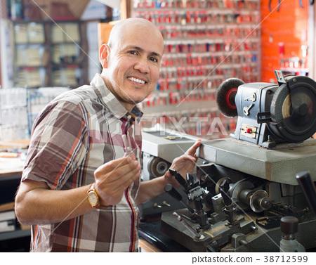 Professional key cutter making door keys copies 38712599
