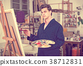 Male artist drawing in studio 38712831