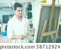 Artist painting on canvas 38712924