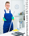 guy in uniform cleaning in office. 38713351