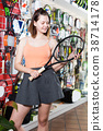 Young women with racket 38714178