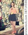 Woman keeping professional racket and balls 38714566