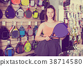 Woman holding professional racket for tennis 38714580