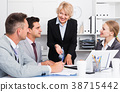 Businesswoman working with colleagues in office 38715442