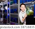 Girl showing aquarium with miniature fish 38716835