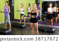 Girls exercising with dumbbells 38717672