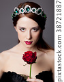 Young redhead girl with tiara and rose 38721887