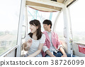 Couple riding a ferris wheel 38726099