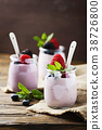 Healthy summer yogurt with berry and mint 38726800