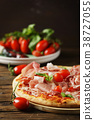 Italian pizza with mozzarella, tomato and bacon 38727055