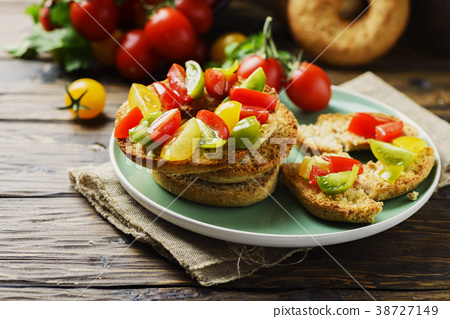 Traditional italian bread frisella with tomatos 38727149