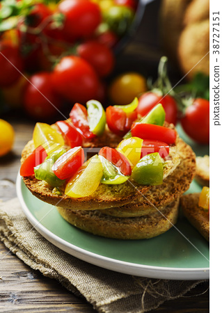 Traditional italian bread frisella with tomatos 38727151