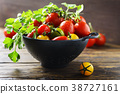 Mix of red, yellow and green tomatos 38727161
