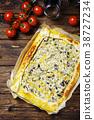 vegetarian tart with ricotta, paprika and zucchini 38727234