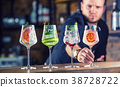 Barman in pub or restaurant  preparing a gin tonic 38728722
