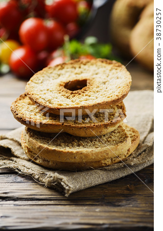 italian bread frisella on the wooden table 38730257
