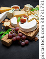 Various types of cheese - parmesan, brie 38731731