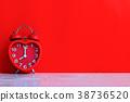 red alarm clock 38736520