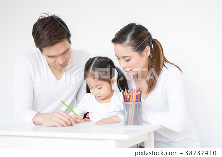 Cute girl working on her school project at home. 38737410