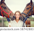 Young rider girl having fun with two her horses 38742883