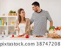 happy couple cooking food at home kitchen 38747208