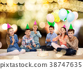 happy children in party hats with birthday cake 38747635