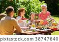 happy family having dinner or summer garden party 38747640