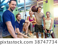 group of friends with sports equipment in gym 38747734