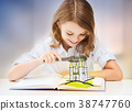 girl with magnifier reading fairytale book 38747760