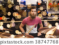 male musician with cymbals at music store 38747768