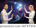 futuristic couple over planet and stars in space 38747958